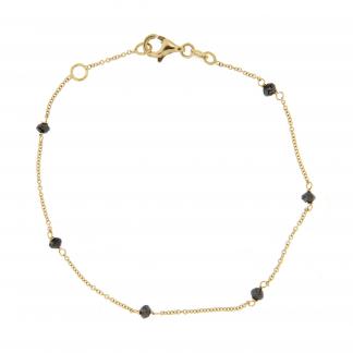 Bracciale in oro giallo 18 kt con diamanti neri.