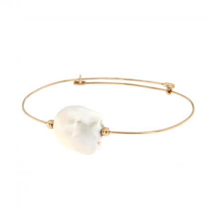 Bracciale in oro rosa 18 kt con perla fresh water barocca.