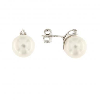 Orecchini in oro bianco 18 kt con diamanti GVS e perle.