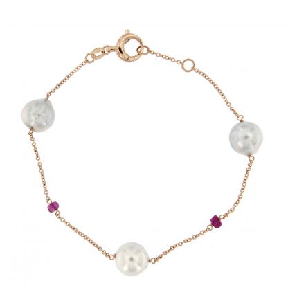Bracciale in oro rosa 18kt con perle akoya e rondelle in rubino.