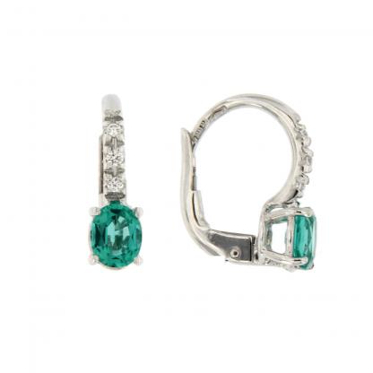 Orecchini con diamanti GVS e smeraldo taglio ovale 5x4mm.