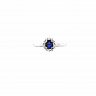 Anello in oro bianco 18kt con zaffiro blu ovale 5x4mm e diamanti G VS1
