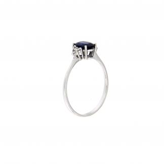 Anello in oro bianco 18kt con zaffiro blu ovale 7x5mm e diamanti G VS1