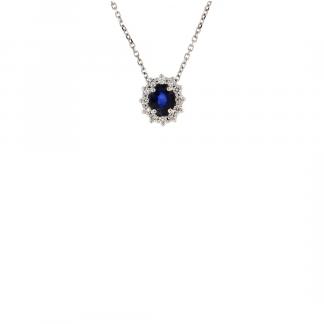 Pendente in oro bianco 18kt con zaffiro blu ovale 5x4mm e contorno in diamanti GVS1